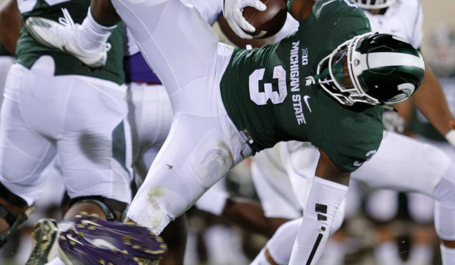 FILE - In this Friday, Sept. 2, 2016, file phot,o Michigan State's LJ Scott (3) dives for a first down against Furman during the third quarter of an NCAA college football game in East Lansing, Mich. Michigan State had a lot to work on after an uninspiring win over Furman in the season opener. But one bright spot for the Spartans was Scott, who looked ready for a bigger role after splitting carries with two other running backs last season. (AP Photo/Al Goldis, File