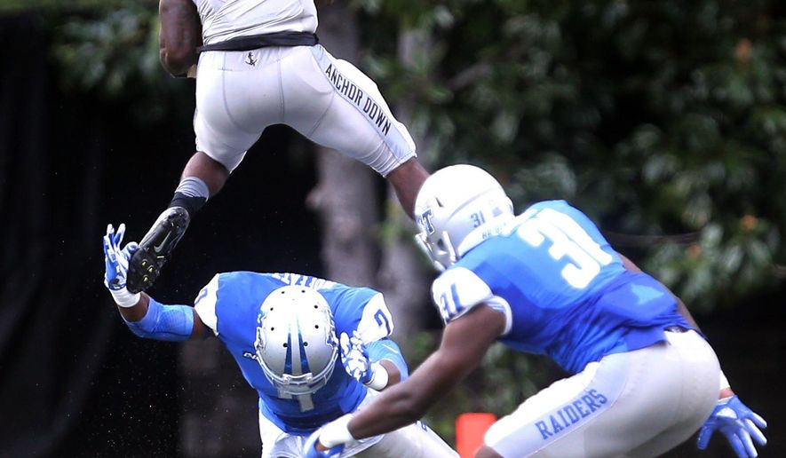 Vanderbilt running back Ralph Webb (7) goes up over Middle Tennessee safety Jovante Moffatt (7) in the first half of an NCAA college football game Saturday, Sept. 10, 2016, in Nashville, Tenn. (Helen Comer /The Tennessean via AP)