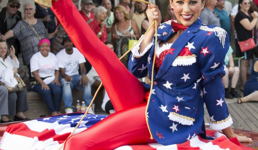 "Miss Connecticut Alyssa Taglia shows her shoe during the 2017 Miss America pageant ""Show Us Your Shoes"" parade Saturday, Sept. 10, 2016, in Atlantic City. (AP Photo/Chris Szagola)"