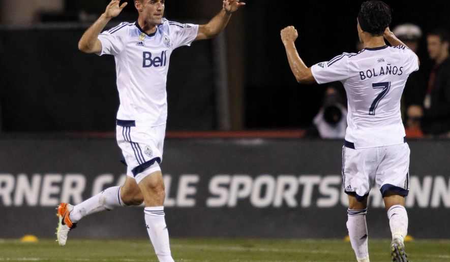 Vancouver Whitecaps midfielder Andrew Jacobson, left, celebrates his goal against the Columbus Crew with midfielder Christian Bolanos during the second half of an MLS soccer match in Columbus, Ohio, Saturday, Sept. 10, 2016. Vancouver won 3-1. (AP Photo/Paul Vernon)