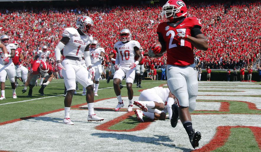 Georgia running back Nick Chubb (27) runs past Nicholls defensive backs Christian Boutte (1) and Jeff Hall (10) for a touchdown in the first half of an NCAA college football game Saturday, Sept. 10, 2016, in Athens, Ga. (AP Photo/Brett Davis)