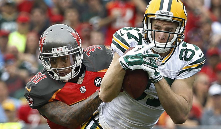 FILE - In this Dec. 21, 2014, file photo, Green Bay Packers wide receiver Jordy Nelson (87) makes a catch in front of Tampa Bay Buccaneers strong safety Bradley McDougald (30) during the first quarter of an NFL football game in Tampa, Fla. With quarterback Aaron Rodgers and receivers Nelson and Randall Cobb, the Packers have one of the league's most potent passing attacks. The Jaguars host the Green Packers on Sunday, Sept. 11. (AP Photo/Brian Blanco, File)