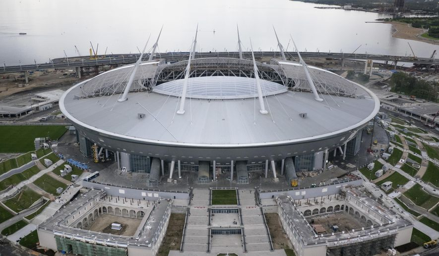 The soccer stadium on Krestovsky Island which will host some 2018 World Cup matches, under construction in St. Petersburg, Russia, Saturday, Sept. 10, 2016. Delegation from FIFA and the 2018 FIFA World Cup Russia Local Organising Committee (LOC) are making an operational planning tour of the Russian stadiums which will host 2018 FIFA World Cup. (AP Photo/Dmitri Lovetsky)