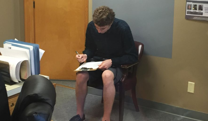 FILE--In this Sept. 6, 2016, file photo, Brock Turner registers as a sex offender at the Greene County sheriff's office in Xenia, Ohio. When the former Stanford University swimmer registered as a sex offender he joined a nationwide legion of criminals that has grown dramatically in recent years and now numbers more than 800,000. As registration has expanded along with the definition of sex crimes, so have legal challenges to a one-size-fits-all punishment that can treat a one-time peeping tom the same as a serial rapist.(Jarod Thrush/Dayton Daily News via AP, file)