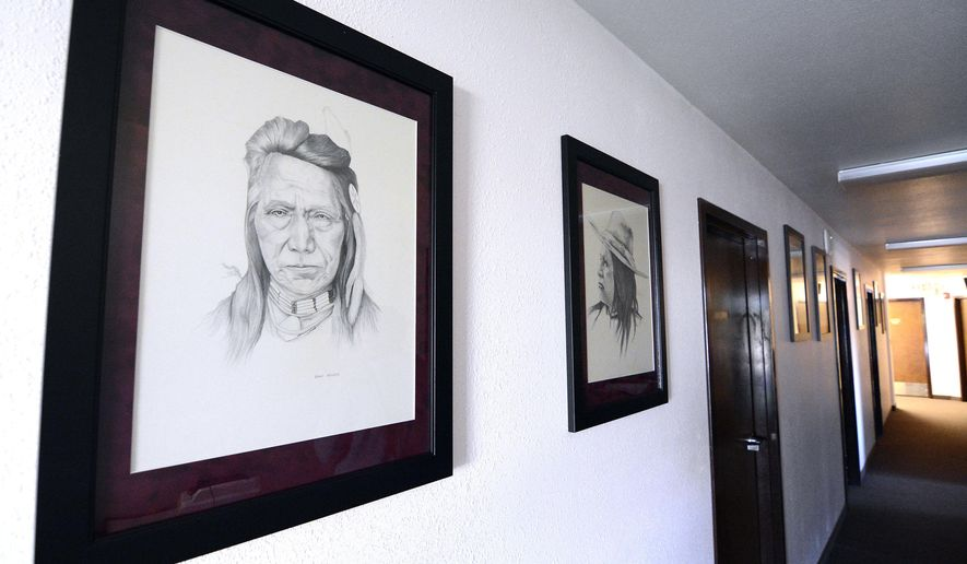 FOR RELEASE SATURDAY, SEPTEMBER 10, 2016, AT 12:01 A.M. MDT.- A group of pencil drawings of Nez Perce tribal leaders hangs in the hallway of the Nez Perce Tribal Executive Chambers Thursday, Aug. 25, 2016 in Lapwai, Idaho. The artist, Steve Allured, worked at Washington State University from 1947-72. (Kyle Mills/Lewiston Tribune via AP)