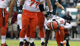 Cleveland Browns' Robert Griffin III is slow to get up after a hit during the second half of an NFL football game against the Philadelphia Eagles, Sunday, Sept. 11, 2016, in Philadelphia. (AP Photo/Matt Rourke)