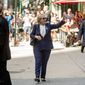 """Democratic presidential candidate Hillary Clinton waves as she leaves an apartment building Sunday, Sept. 11, 2016, in New York. Clinton's campaign said the Democratic presidential nominee left the 9/11 anniversary ceremony in New York early after feeling """"overheated."""" (AP Photo/Andrew Harnik)"""