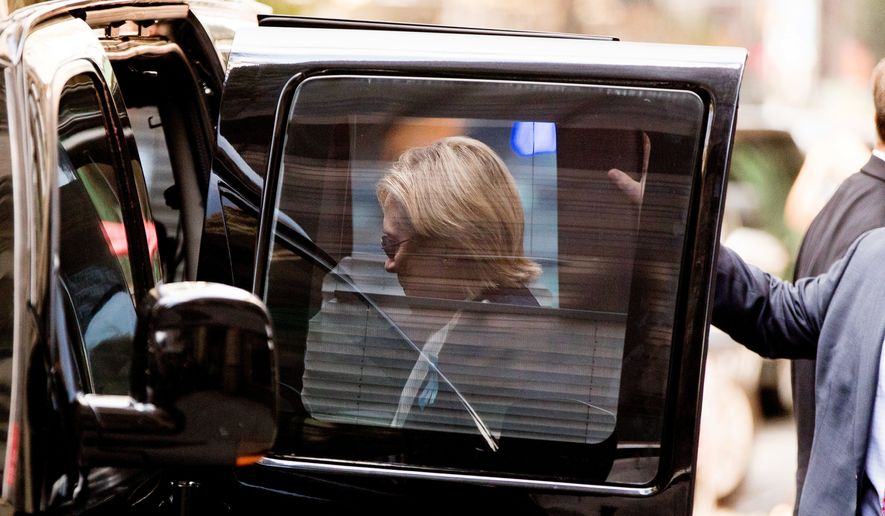 Hillary Clinton nearly fainted at a 9/11 commemoration event in New York Sunday. Her campaign then said she was suffering from pneumonia. (Associated Press)