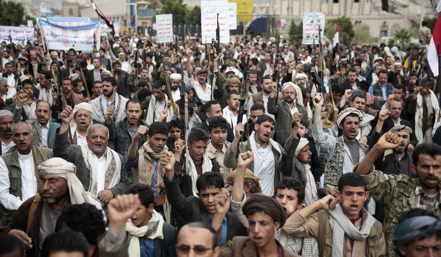 Shiite tribesmen, known as Houthis, hold their weapons as they chant slogans during a rally in Sanaa, Yemen, on July 18. (Associated Press)