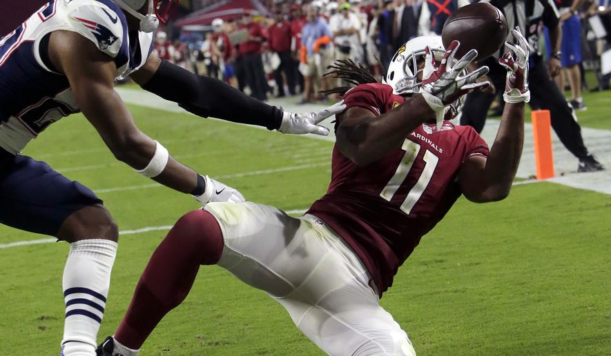 Arizona Cardinals wide receiver Larry Fitzgerald (11) catches his career 100th touchdown pass during the second half of an NFL football game against the New England Patriots, Sunday, Sept. 11, 2016, in Glendale, Ariz. (AP Photo/Rick Scuteri)