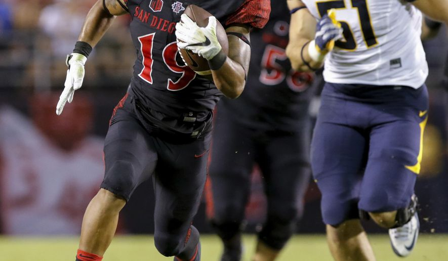 San Diego State running back Donnel Pumphrey heads to the end zone for a touchdown in front California's Cameron Saffle during the first half of an NCAA college football game Saturday, Sept. 10, 2016, in San Diego. (AP Photo/Don Boomer)