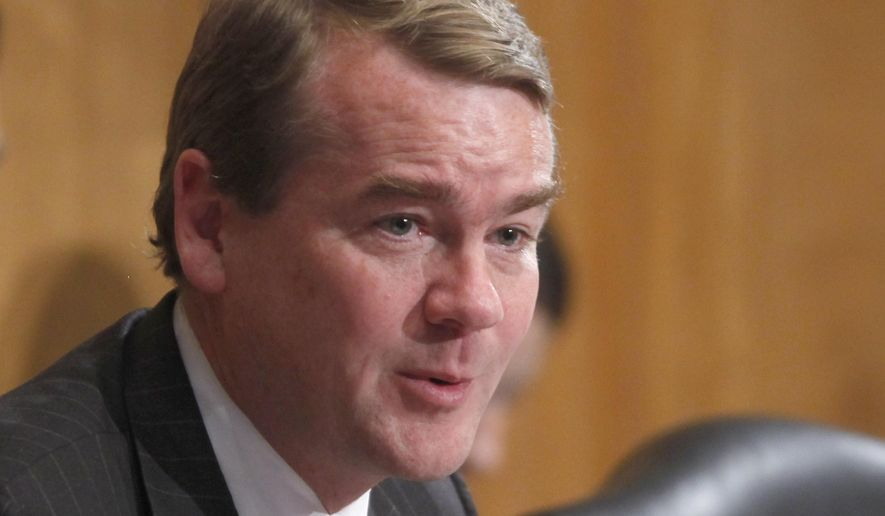 FILE - This May 21, 2013 file photo shows Sen. Michael Bennet, D-Colo. on Capitol Hill in Washington. Three candidates for Colorado's U.S. Senate race debated for the first time Saturday, Sept. 10, 2016, in Grand Junction. The Denver Post reports that fast-rising Democratic star Bennet sparred with conservative Air Force veteran Darryl Glenn over bipartisanship and federal debt. (AP Photo/Charles Dharapak, File)