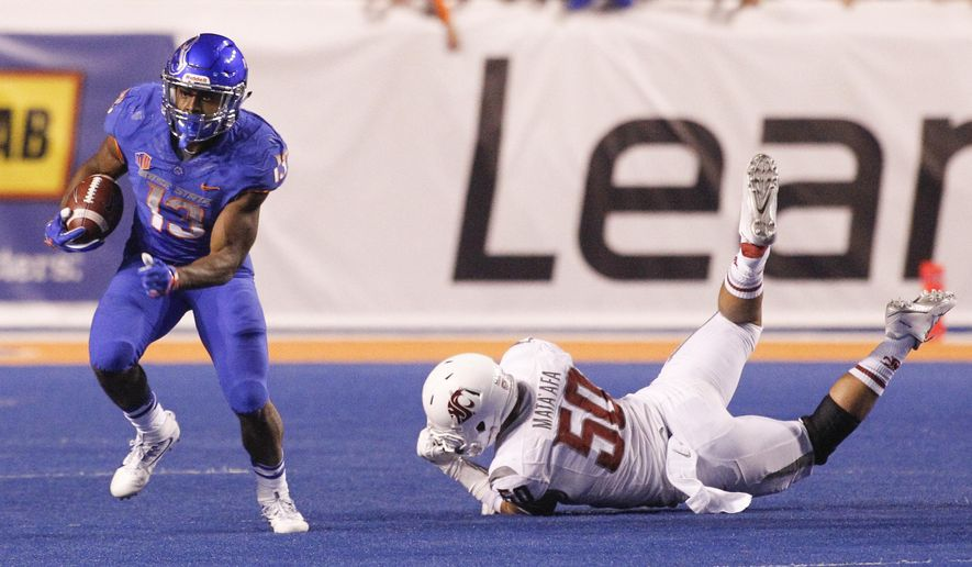 Boise State running back Jeremy McNichols (13) runs the ball past Washington State defensive linesman Hercules Mata'afa (50) during the second half of an NCAA college football game in Boise, Idaho, on Saturday, Sept. 10, 2016. (AP Photo/Otto Kitsinger)