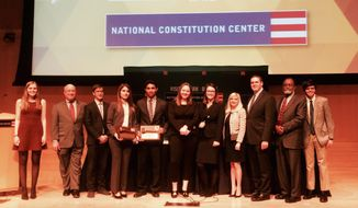 Julie Silverbrook (fourth from right), executive director of The Constitutional Sources Project, and Josh Blackman, president of Harlan Institute (third from right), stand with winners and judges of ConSource-Harlan Institute Virtual Supreme Court Competition in April 2016. The students had to write appellate briefs on an affirmative-action case, and argue against other student teams before a panel of attorneys. Image courtesy of ConSource.