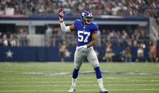 New York Giants linebacker Keenan Robinson (57) signals from the field during an NFL football game against the Dallas Cowboys on Sunday, Sept. 11, 2016, in Arlington, Texas. (AP Photo/Michael Ainsworth)