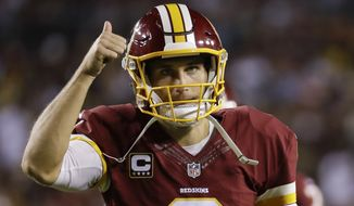 Washington Redskins quarterback Kirk Cousins (8) signals a thumbs up as he leaves the field during the first half of an NFL football game against the Pittsburgh Steelers in Landover, Md., Monday, Sept. 12, 2016. (AP Photo/Patrick Semansky)