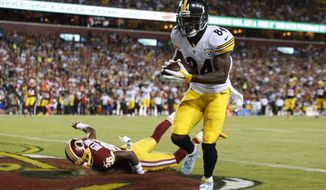 Washington Redskins cornerback Bashaud Breeland (26) lands on the turf as Pittsburgh Steelers wide receiver Antonio Brown (84) scores a touchdown during the second half of an NFL football game in Landover, Md., Monday, Sept. 12, 2016. (AP Photo/Alex Brandon)