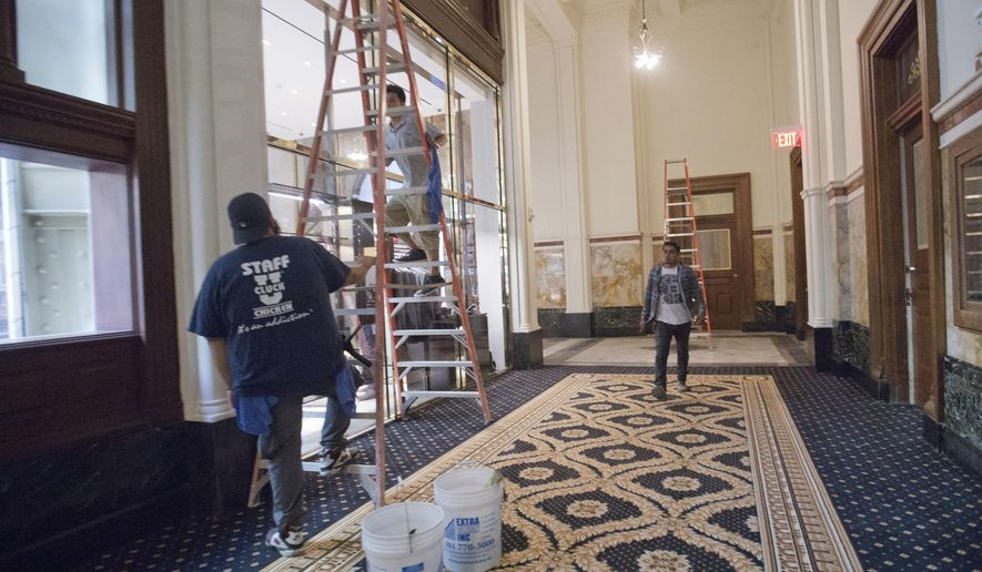 "Work continues inside the Trump International Hotel in downtown Washington, Monday, Sept. 12, 2016 in Washington. The luxury hotel Donald Trump has built in an iconic downtown Washington building is set to open. The Trump International Hotel will begin serving guests Monday. There won't be any fanfare around the opening, which is known as a ""soft opening."" Grand-opening ceremonies are being planned for October. The Trump Organization won a 60-year lease from the federal government to transform the Old Post Office building on Pennsylvania Avenue into a hotel. (AP Photo/Pablo Martinez Monsivais)"