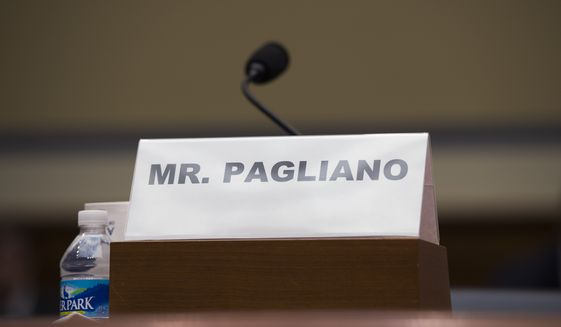 """The name plate for witness Bryan Pagliano, former senior adviser, Information Resource Management, State Department, who did not appear, sits on the witness table on Capitol Hill in Washington, Tuesday, Sept. 13, 2016, during a hearing of the House Oversight and Government Reform Committee on """"Examining Preservation of State Department Records."""" (AP Photo/Molly Riley) ** FILE **"""