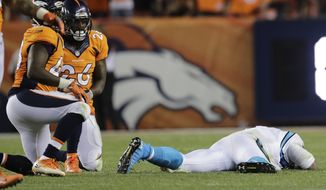 FILE - In this Sept. 8, 2016, file photo, Carolina Panthers quarterback Cam Newton (1) lies on the turf after a roughing the passer penalty was called on Denver Broncos free safety Darian Stewart (26) during the second half of an NFL football game in Denver. s some Broncos players prepare to face the financial consequences of their helmet-to-helmet hits on Cam Newton, they insist they're not a dirty defense, although they don't really mind if that's their reputation. (AP Photo/Joe Mahoney, File)