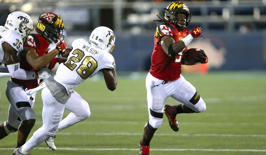 FILE - In this Sept. 9, 2016, file photo, Maryland running back Trey Edmunds (9) carries the ball against Florida International safety Deonte Wilson during the second half of an NCAA college football game in Miami. Maryland has learned how to beat other teams instead of beating itself. The Terps are 2-0 and without a turnover under coach DJ Durkin. (David Santiago/El Nuevo Herald via AP, File)