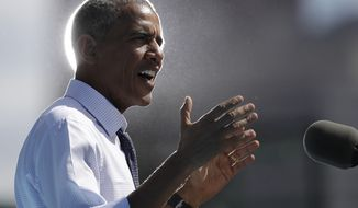President Barack Obama speaks at campaign event for Democratic presidential candidate Hillary Clinton at Eakins Oval in Philadelphia, Tuesday, Sept. 13, 2016. (AP Photo/Carolyn Kaster)