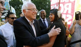 Sen. Bernie Sanders, I-Vt., left, greets Jasilyn Charger, a member of the Cheyenne River Sioux Tribal Youth Council, after Charger spoke to a group of supporters of the Standing Rock Sioux Tribe who were rallying in opposition of the Dakota Access oil pipeline, during a rally by the White House, Tuesday, Sept. 13, 2016, in Washington. Sanders also spoke at the rally. (AP Photo/Jacquelyn Martin) ** FILE **