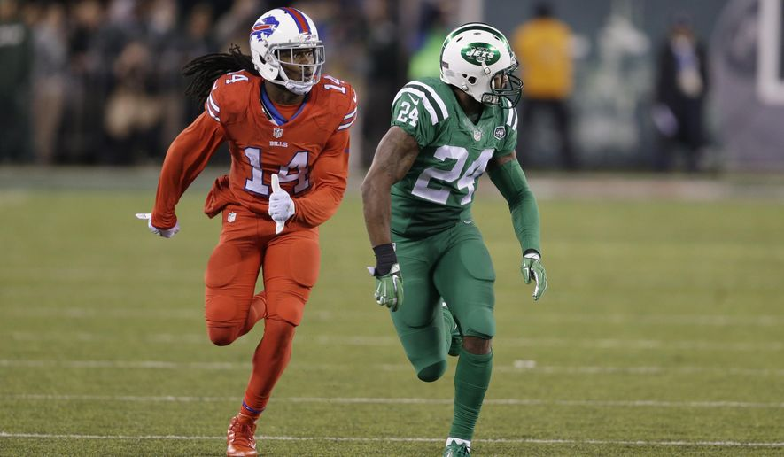 """FILE - In this Nov. 12, 2015, file photo, Buffalo Bills wide receiver Sammy Watkins, left, is defended by New York Jets cornerback Darrelle Revis during the first half of an NFL football game, in East Rutherford, N.J. The NFL isn't colorblind to the concerns of its TV audience regarding the """"Color Rush"""" alternate uniforms the Bills and Jets will wear Thursday night, Sept. 14, 2016. That's a switch from last year, when Buffalo wore all red and the Jets all green during their prime-time game on Nov. 12. The combinations led to colorblind viewers complaining they couldn't determine which team was which.  (AP Photo/Seth Wenig, File)"""