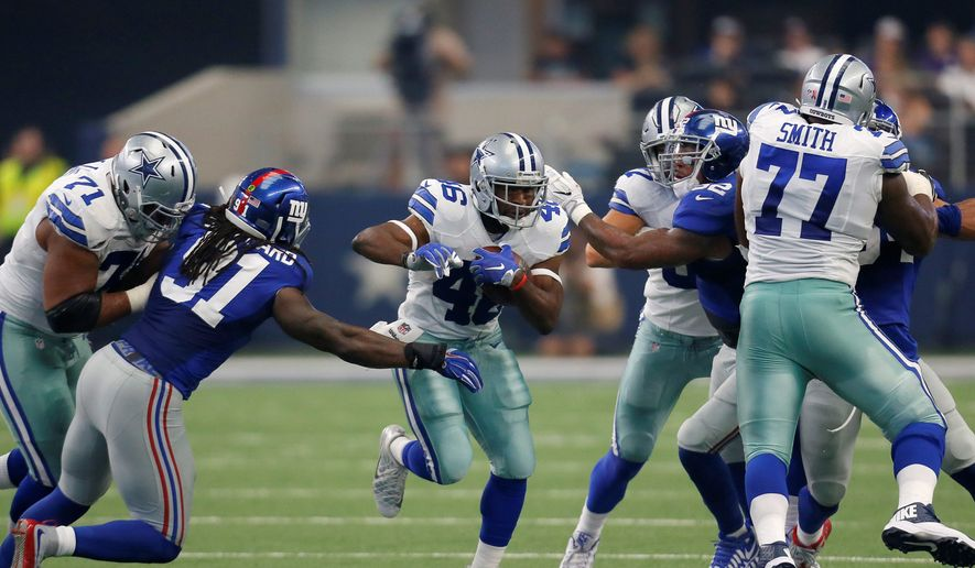 Dallas Cowboys running back Alfred Morris (46) runs the ball as New York Giants linebacker Kelvin Sheppard (91) attempts the stop during an NFL football game, Sunday Sept. 11,  2016, in Arlington, Texas. (AP Photo/Roger Steinman)