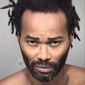 Marc LaQuon Payne was jailed without bond after authorities said he drove a car into two police officers outside a Phoenix gas station on Tuesday. He then scuffled with a third officer who got away. (Maricopa County Sheriff via Associated Press)