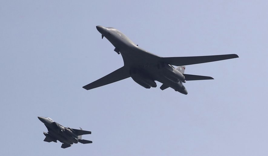 """CORRECTS THE SECOND SENTENCE TO REMOVE REFERENCE TO """"NUCLEAR-CAPABLE"""" - A U.S. B-1B bomber, right, flies over Osan Air Base with a U.S. jet in Pyeongtaek, South Korea, Tuesday, Sept. 13, 2016. The United States on Tuesday sent two supersonic bombers streaking over ally South Korea in a show of force meant to cow North Korea after its recent nuclear test, and also to settle rattled nerves in the South. (AP Photo/Lee Jin-man)"""