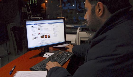 A man uses the internet at a cafe in Damascus, Syria. (Associated Press)