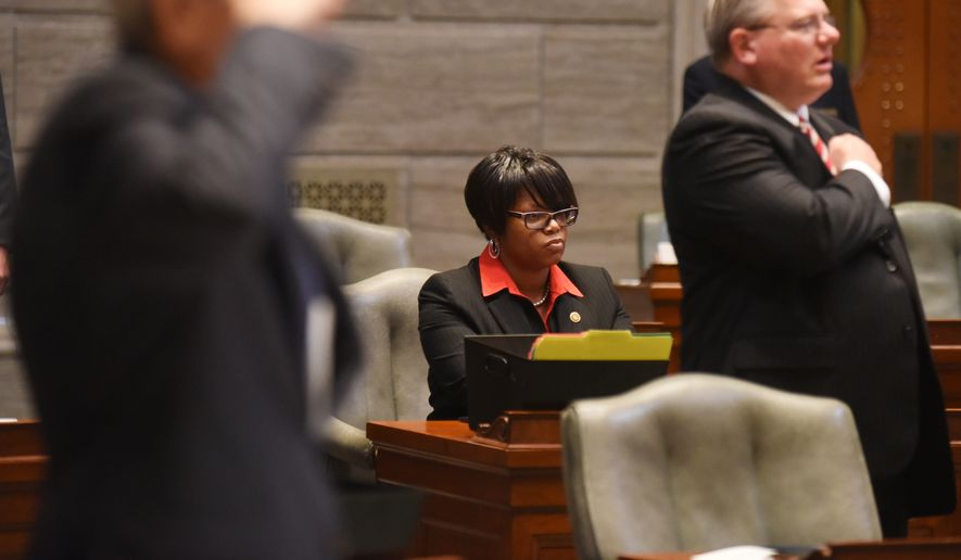 Sen. Jamilah Nasheed, D-St. Louis, chose to remain seated as the Pledge of Allegiance was recited Wednesday, Sept. 14, 2016, in the Missouri Senate chambers. Legislative bodies met in their respective Capitol chambers in an attempt to override Gov. Jay Nixon's veto of several pieces of legislation. (Julie Smith/News Tribune via AP)