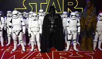 "In this Dec. 16, 2015, file photo, characters from the file, including stormtroopers and Darth Vader pose for photographers upon arrival at the European premiere of the film ""Star Wars: The Force Awakens"" in London.   (Photo by Jonathan Short/Invision/AP) ** FILE **"