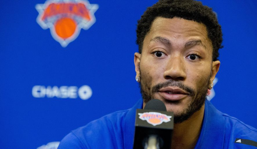 FILE - In this June 24, 2016, file photo, Derrick Rose speaks during a news conference at Madison Square Garden in New York. The woman at the center of a sexual assault case that accuses NBA star Derrick Rose and two others of gang rape is leading two starkly different lives. She has kept a painful secret from her own parents while somehow balancing a dual existence, one as dedicated college student who now even more than ever cherishes her large, traditional Mexican family as she prepares for the reality that her name might soon be made public as the plaintiff in this high-profile civil case. (AP Photo/Mary Altaffer, File)
