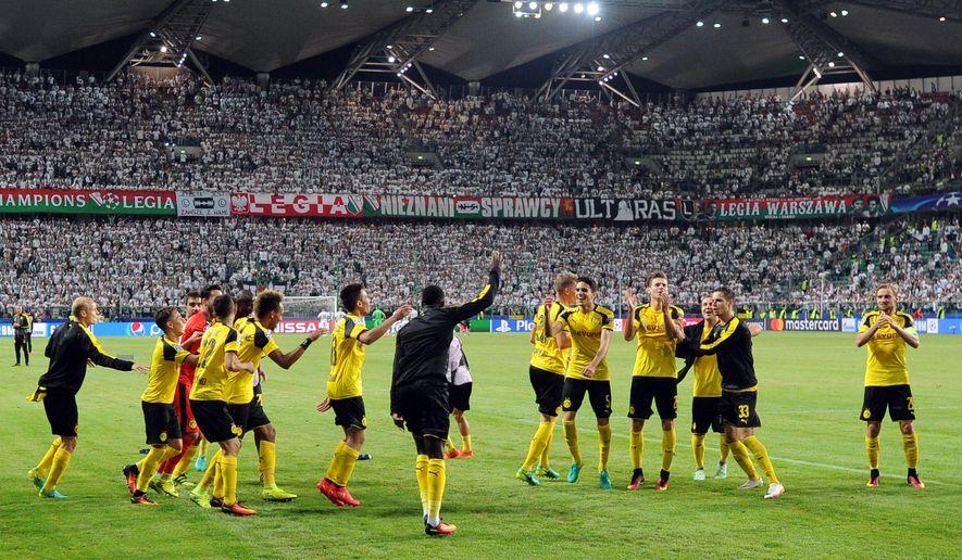 Dortmund players celebrate after the Champions League Group F soccer match between Legia Warsaw and Dortmund at Stadion Wojska Polskiego in Warsaw, Poland, Wednesday, Sept. 14, 2016. (AP Photo/Alik Keplicz)