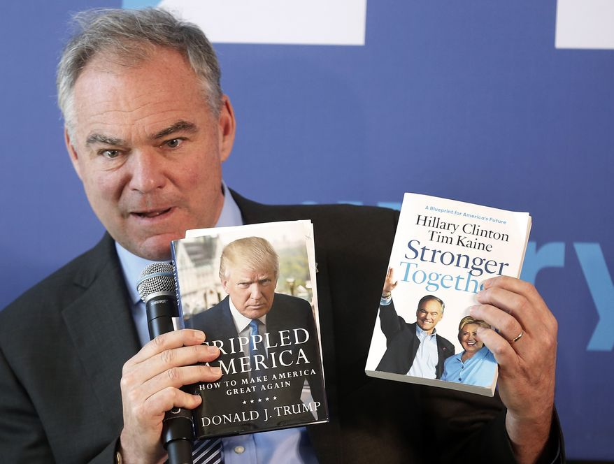 Democratic vice presidential candidate, Sen. Tim Kaine, D-Va. holds up books to show the difference between the two campaigns for president, Thursday, Sept. 15, 2016, in Portsmouth, N.H. (AP Photo/Jim Cole)