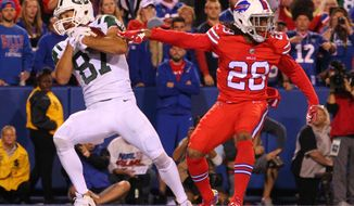 New York Jets wide receiver Eric Decker (87) catches a touchdown reception in front of Buffalo Bills cornerback Ronald Darby (28) during the first half an NFL football game on Thursday, Sept. 15, 2016, in Orchard Park, N.Y. (AP Photo/Bill Wippert)