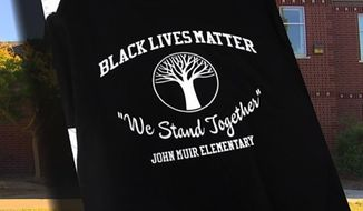 Teachers at a Seattle elementary school are planning to wear Black Lives Matter T-shirts in class on Friday. (KING 5)