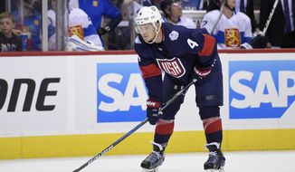 United States defenseman John Carlson (4) looks on against Finland during the first period of an exhibition hockey game, part of the World Cup of Hockey, Tuesday, Sept. 13, 2016, in Washington. (AP Photo/Nick Wass)