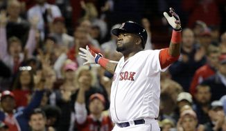 Boston Red Sox designated hitter David Ortiz celebrates his solo home run in the eighth inning of a baseball game against the New York Yankees at Fenway Park, Thursday, Sept. 15, 2016, in Boston. (AP Photo/Elise Amendola)