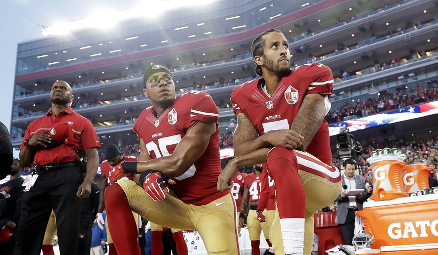 FILE - Int his Monday, Sept. 12, 2016, file photo, San Francisco 49ers safety Eric Reid (35) and quarterback Colin Kaepernick (7) kneel during the national anthem before an NFL football game against the Los Angeles Rams in Santa Clara, Calif. (AP Photo/Marcio Jose Sanchez, File) **FILE**