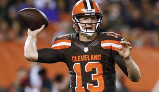 FILE - In this Sept. 1, 2016, file photo, Cleveland Browns quarterback Josh McCown throws in the first half of an NFL preseason football game against the Chicago Bears, in Cleveland. McCown spent the summer in trade rumors and Robert Griffin III's shadow. But now that RG3 is injured and out for at least eight games, McCown is once again starting at quarterback for the Browns.  (AP Photo/Ron Schwane, File)