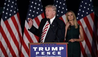 Ivanka Trump, right, looks on as her father Republican presidential candidate Donald Trump delivers a policy speech on child care, Tuesday, Sept. 13, 2016, in Aston, Penn. (AP Photo/Evan Vucci)
