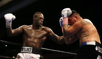Deontay Wilder punches Chris Arreola during the WBC heavyweight boxing match, Saturday, July 16, 2016, in Birmingham, Ala. (AP Photo/Brynn Anderson)