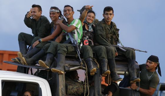 Three months into the implementation of a peace accord with Bogata, rebels of the Revolutionary Armed Forces of Colombia (FARC) have surrendered what critics say is a token number of weapons while the production of coca has skyrocketed. (Associated Press/File)