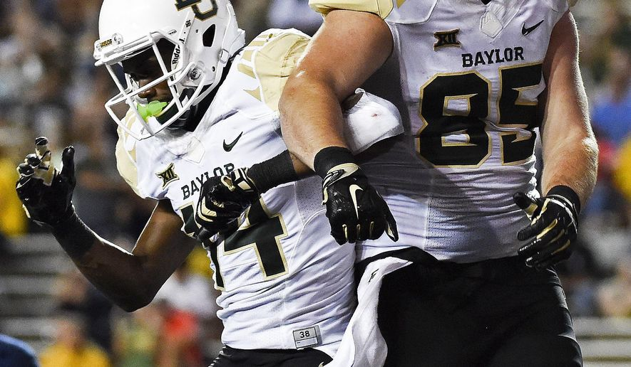 Baylor tight end Jordan Feuerbacher (85) celebrates his touchdown reception with Chris Platt in the second half of an NCAA college football game against Rice, Friday, Sept. 16, 2016, in Houston. (AP Photo/Eric Christian Smith)