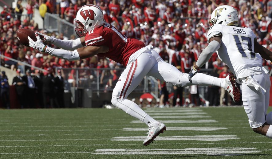 FILE - In this Sept. 10, 2016, file photo, Wisconsin's Jazz Peavy makes a catch in front of Akron's Bryce Jones during an NCAA college football game in Madison, Wis. Peavy had a breakout game last week with seven catches for 100 yards and two scores. Wisconsin plays Georgia State this week. (AP Photo/Morry Gash, File)