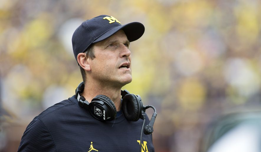 Michigan head coach Jim Harbaugh looks up at the scoreboard after a Michigan touchdown in the first quarter of an NCAA college football game against Colorado at Michigan Stadium in Ann Arbor, Mich., Saturday, Sept. 17, 2016.  Michigan won 45-28. (AP Photo/Tony Ding)