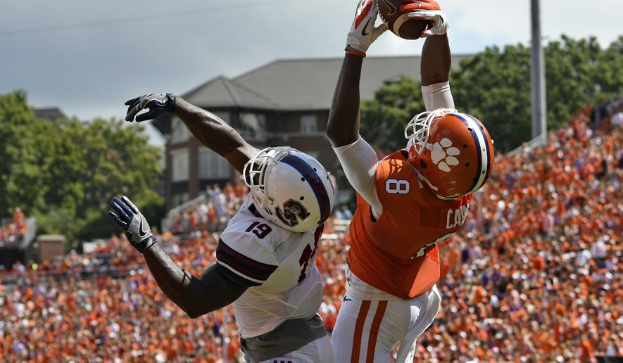 Clemson's Deon Cain, right, pulls in a pass for a touchdown while being defended by South Carolina State's Devondre Powell during the first half of an NCAA college football game Saturday, Sept. 17, 2016, in Clemson, S.C. (AP Photo/Richard Shiro)
